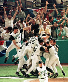 The Florida Marlins celebrate their 32 win over the Cleveland Indians in game seven of the World Series 26 October at Pro Player Stadium The Marlins...