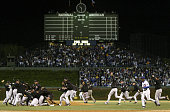 The Florida Marlins celebrate their 96 win over the Chicago Cubs during game seven of the National League Championship Series October 15 2003 at...