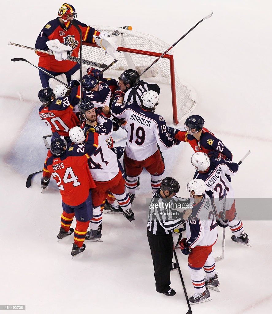 The Florida Panthers and the Columbus Blue Jackets fight during first period action at the BB&T Center on April 12, 2014 in Sunrise, Florida. The Blue Jackets defeated the Panthers 3-2.