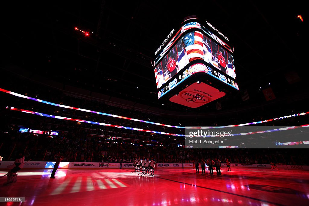 The Florida Panthers and the St Louis Blues line up on the ice for the national anthem prior to the start of the game at the BB&T Center on November 1, 2013 in Sunrise, Florida.