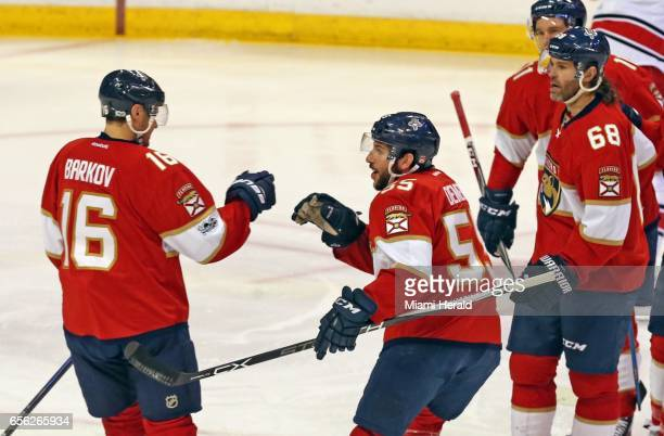 The Florida Panthers' Barkov Aleksander celebrates with Jason Demers after Barkov scored against the Carolina Hurricanes in the first period at the...