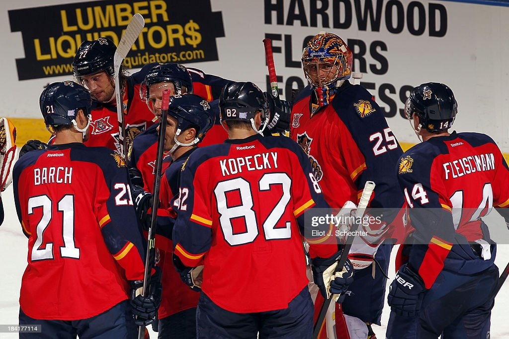 The Florida Panthers celebrate after a 6-3 win over the Pittsburgh Penguins at the BB&T Center on October 11, 2013 in Sunrise, Florida.