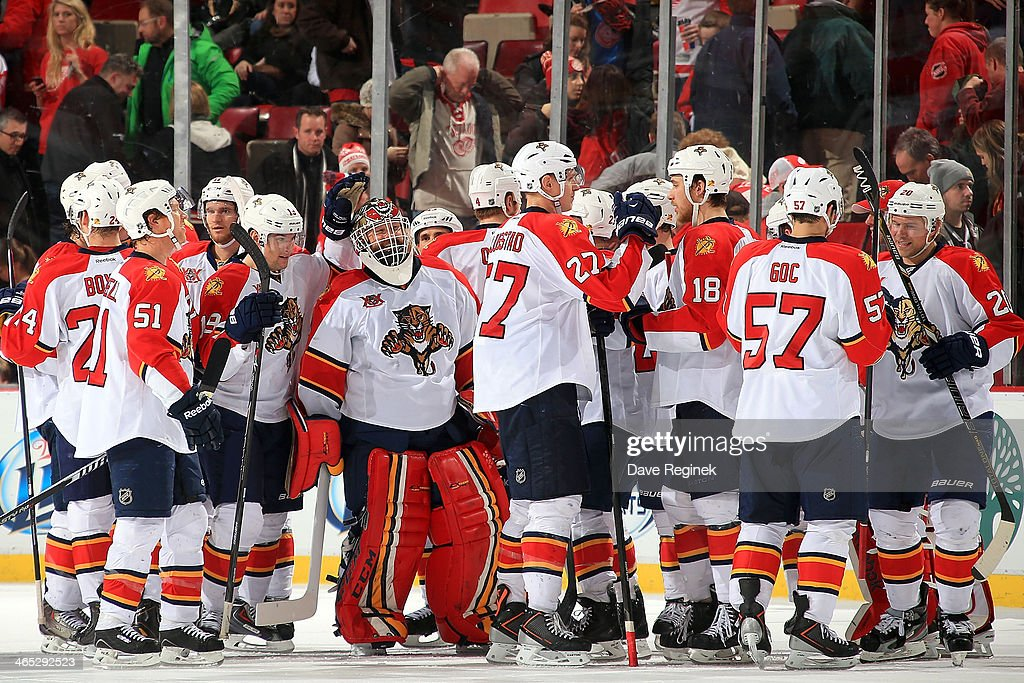 The Florida Panthers celebrate after an NHL game against the Detroit Red Wings on January 26, 2014 at Joe Louis Arena in Detroit, Michigan. Florida defeated Detroit 5-4 in a shootout (Photo by Dave Reginek/NHLI via Getty Images)2