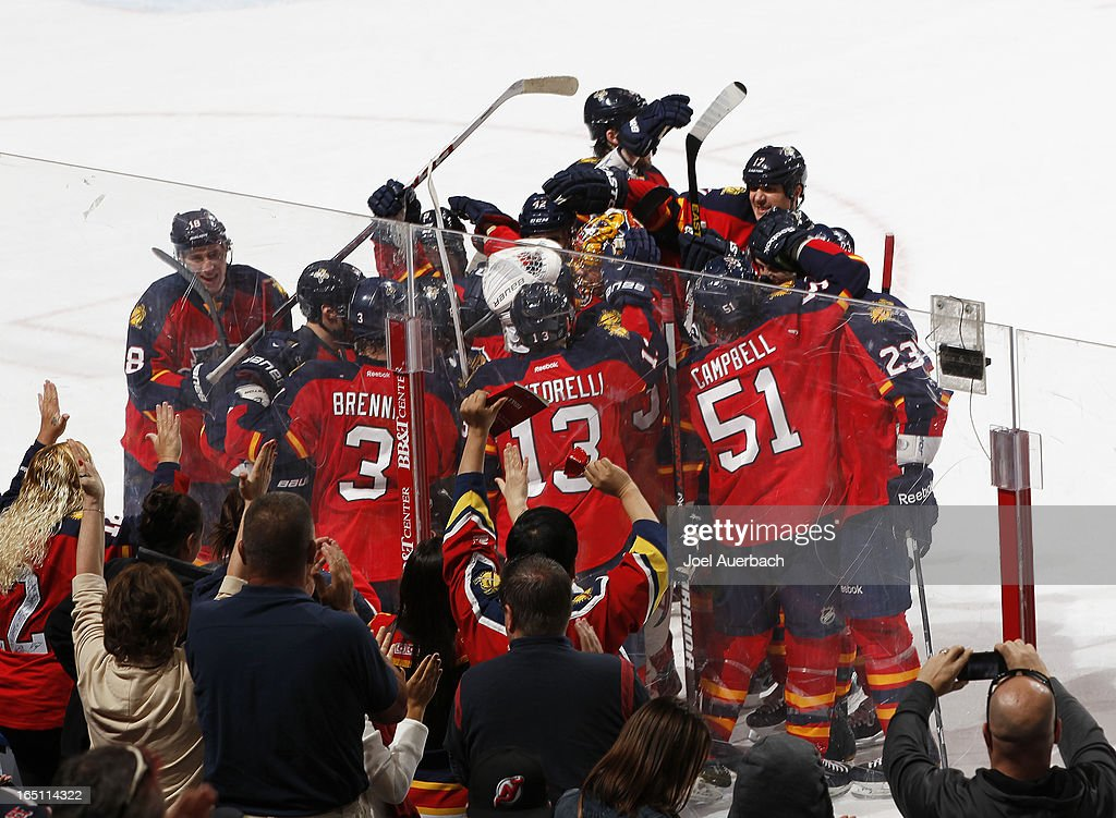 The Florida Panthers celebrate their overtime win against the New Jersey Devils at the BB&T Center on March 30, 2013 in Sunrise, Florida. The Panthers defeated the Devils 3-2 in overtime.