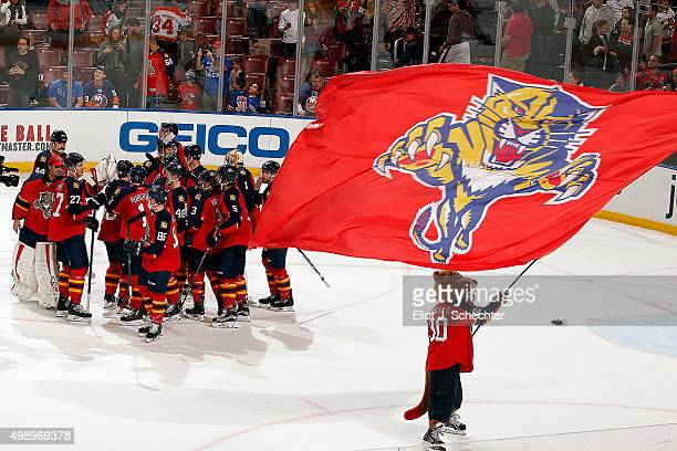 The Florida Panthers celebrate their shoot out win against the New York Islanders at the BBT Center on November 27 2015 in Sunrise Florida