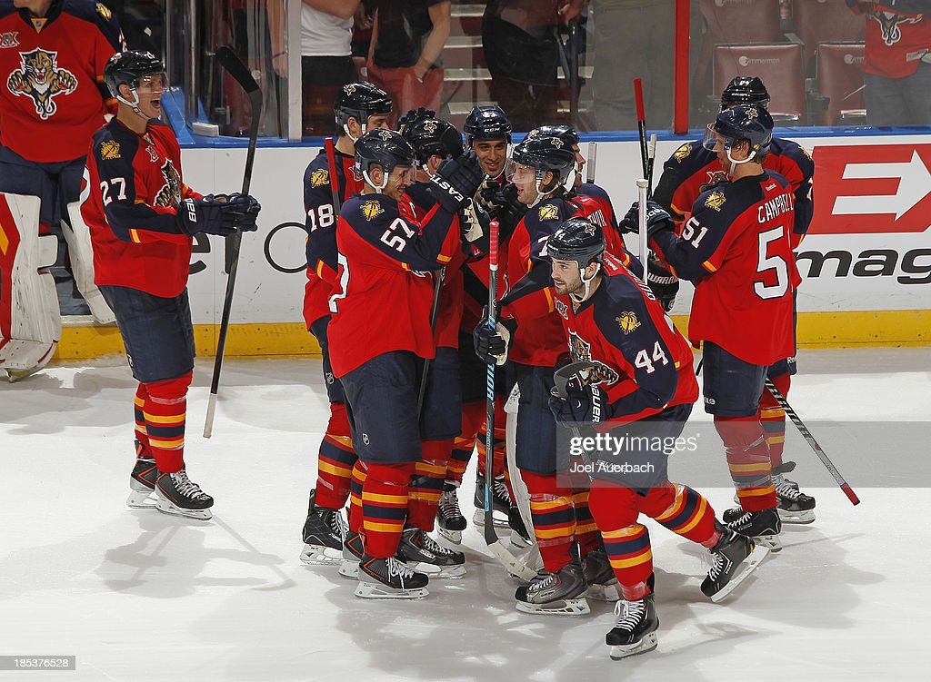 The Florida Panthers celebrate their shoot-out victory against the Minnesota Wild at the BB&T Center on October 19, 2013 in Sunrise, Florida. The Panthers defeated the Wild 2-1 in a shoot-out.