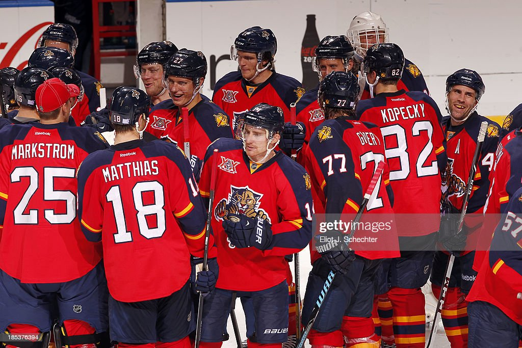 The Florida Panthers celebrate their shoot-out win against the Minnesota Wild at the BB&T Center on October 19, 2013 in Sunrise, Florida.