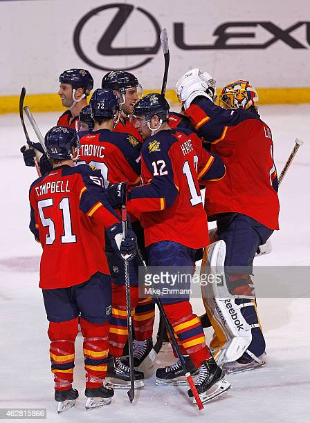 The Florida Panthers celebrate winning a game against the Los Angeles Kings at BBT Center on February 5 2015 in Sunrise Florida
