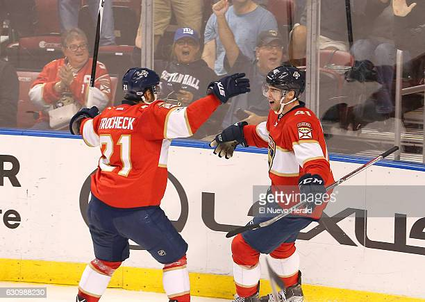 The Florida Panthers' Gregg McKegg celebrates with teammate Vincent Trocheck left after scoring a goal against the Winnipeg Jets in the second period...