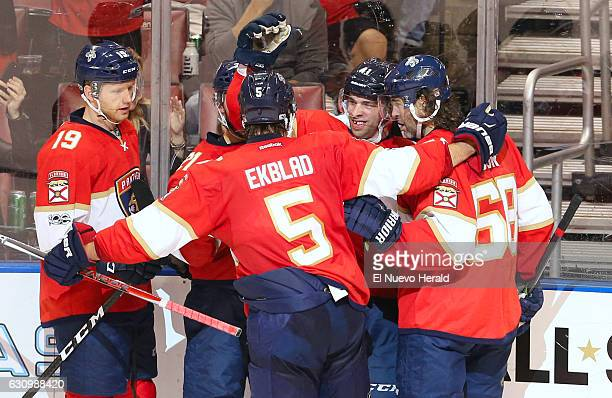 The Florida Panthers' Gregg McKegg celebrates with teammates after scoring a goal against the Winnipeg Jets in the second period at BBT Center in...