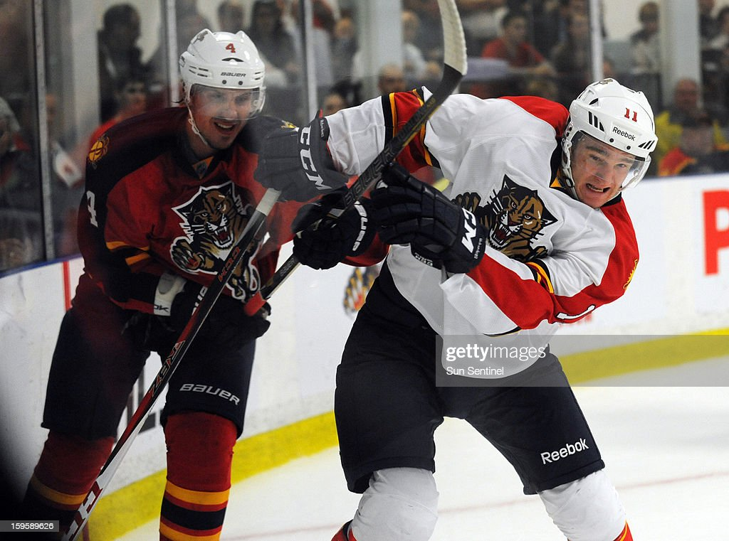 The Florida Panthers' Jonathan Huberdeau, right, battles with Keaton Ellerby during a scrimmage at the Saveology.com Iceplex in Coral Springs, Florida, on Wednesday, January 16, 2013.