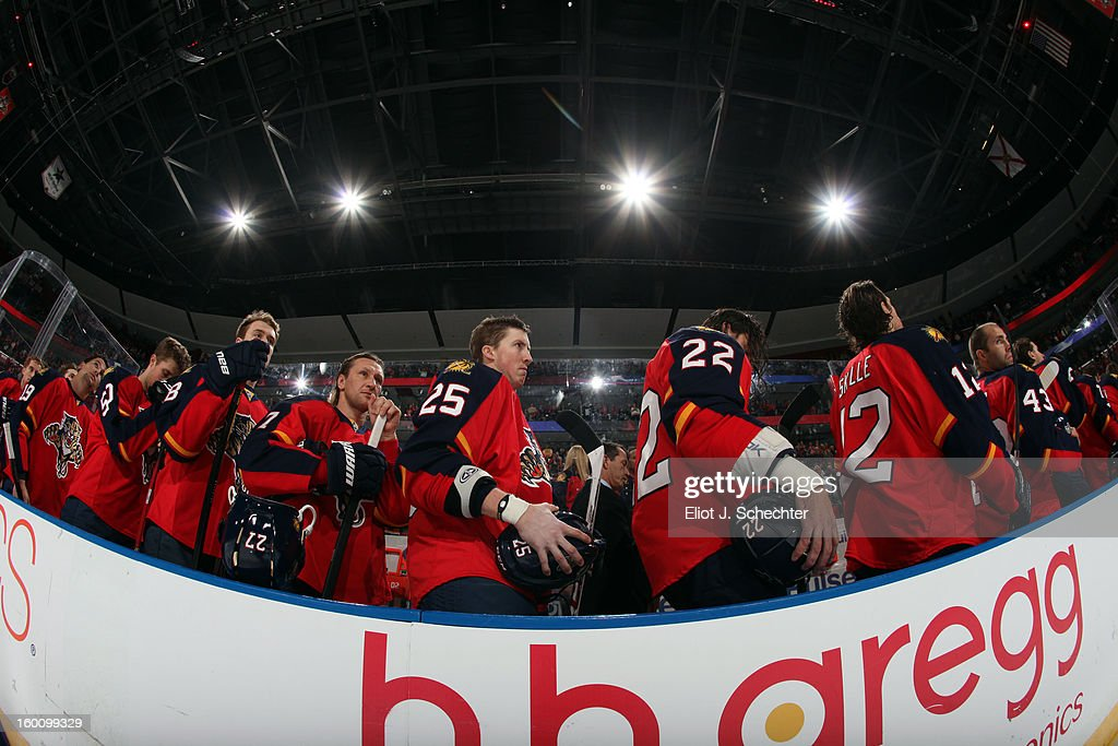 The Florida Panthers line up on the bench for the National Anthems prior to the start of the game against the Ottawa Senators at the BB&T Center on January 24, 2013 in Sunrise, Florida.