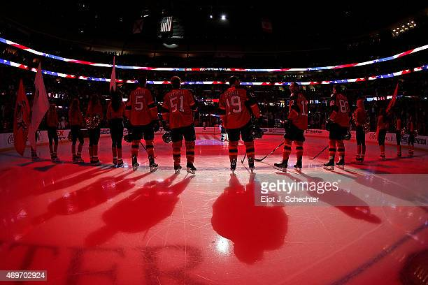 The Florida Panthers line up on the ice for the national anthem prior to the start of the game against the New Jersey Devils at the BBT Center on...