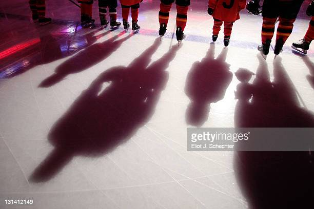 The Florida Panthers line up on the ice with junior skaters for the national anthem prior to the start of the game against the Chicago Blackhawks at...