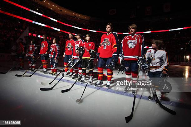 The Florida Panthers line up on the ice with junior skaters for the National Anthem prior to the start of the game against the Toronto Maple Leafs at...