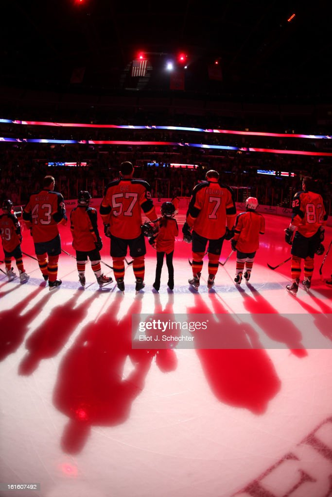 The Florida Panthers line up with junior skaters for the national anthem prior to the start of the game against the Washington Capitals at the BB&T Center on February 12, 2013 in Sunrise, Florida.