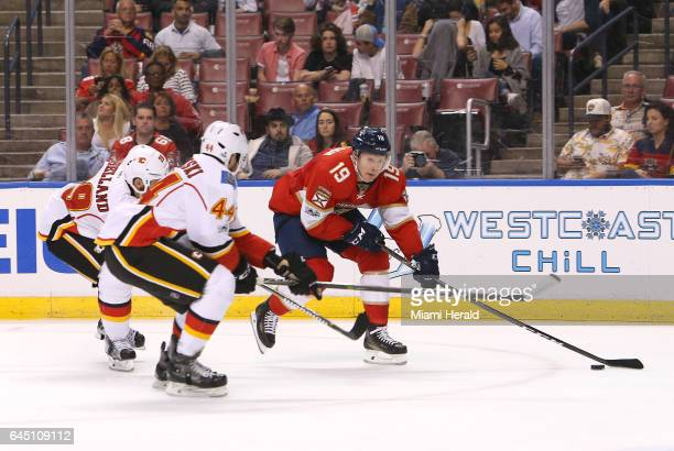 The Florida Panthers' Michael Matheson carries the puck against the Calgary Flames' Matt Bartkowski and Deryk Engelland during the second period at...