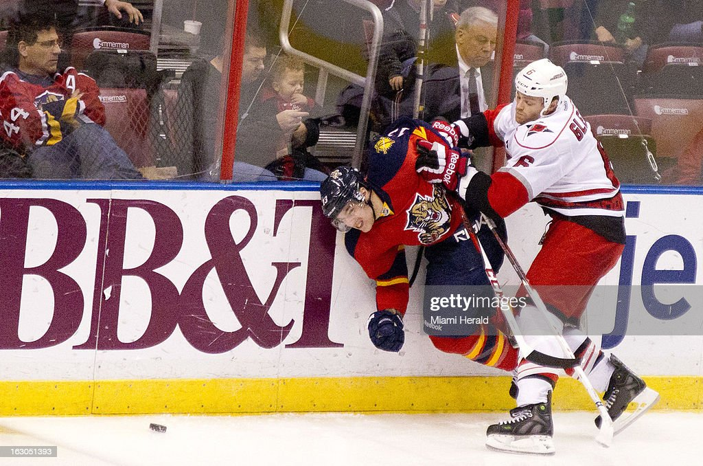 The Florida Panthers' Mike Santorelli gets manhandled by the Carolina Panthers' Tim Gleason, right, in the third period at the BB&T Center in Sunrise, Florida, Sunday, March 3, 2013. The Hurricanes defeated the Panthers, 3-2.