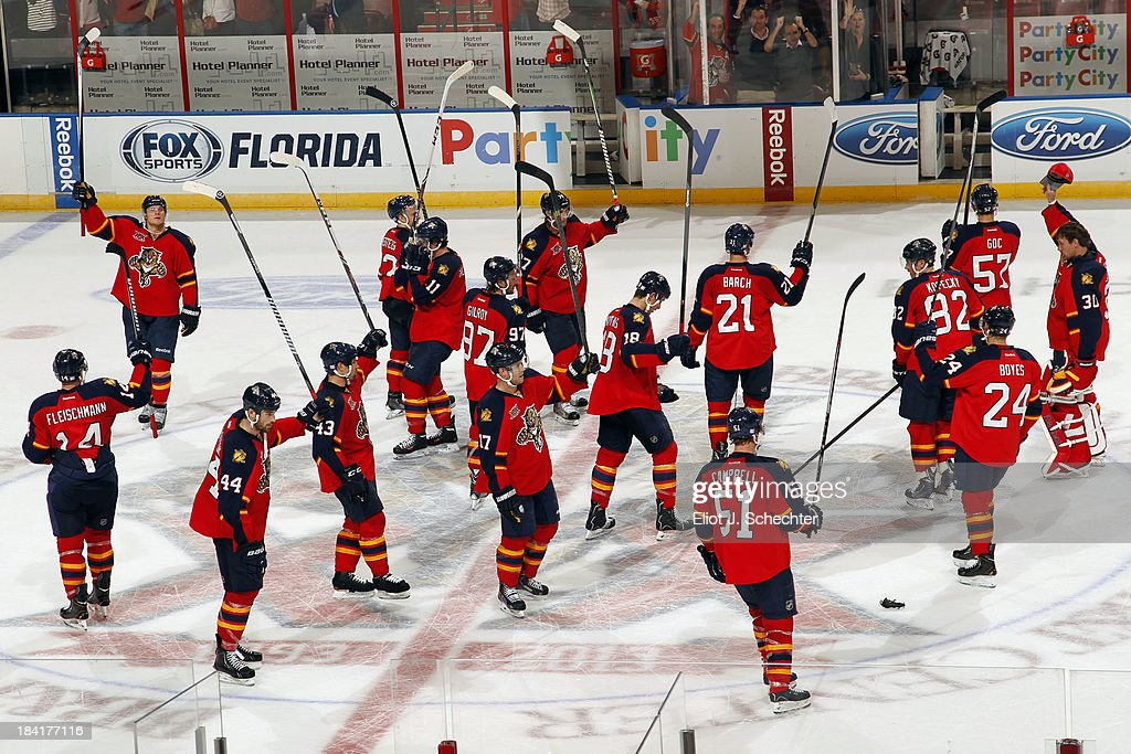 The Florida Panthers salute the fans after a 6-3 win over the Pittsburgh Penguins at the BB&T Center on October 11, 2013 in Sunrise, Florida.