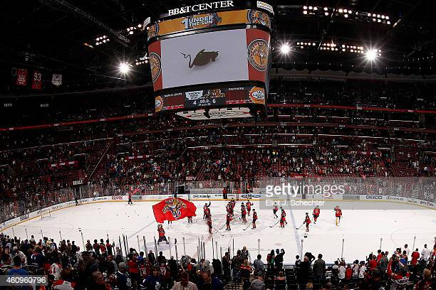 The Florida Panthers salute the fans after their win against the Toronto Maple Leafs at the BBT Center on December 28 2014 in Sunrise Florida