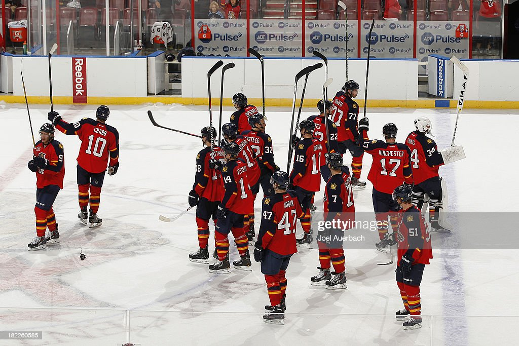 The Florida Panthers salute the fans at the conclusion of the game against the Tampa Bay Lightning at the BB&T Center on September 28, 2013 in Sunrise, Florida. The Panthers defeated the Lightning 5-3.