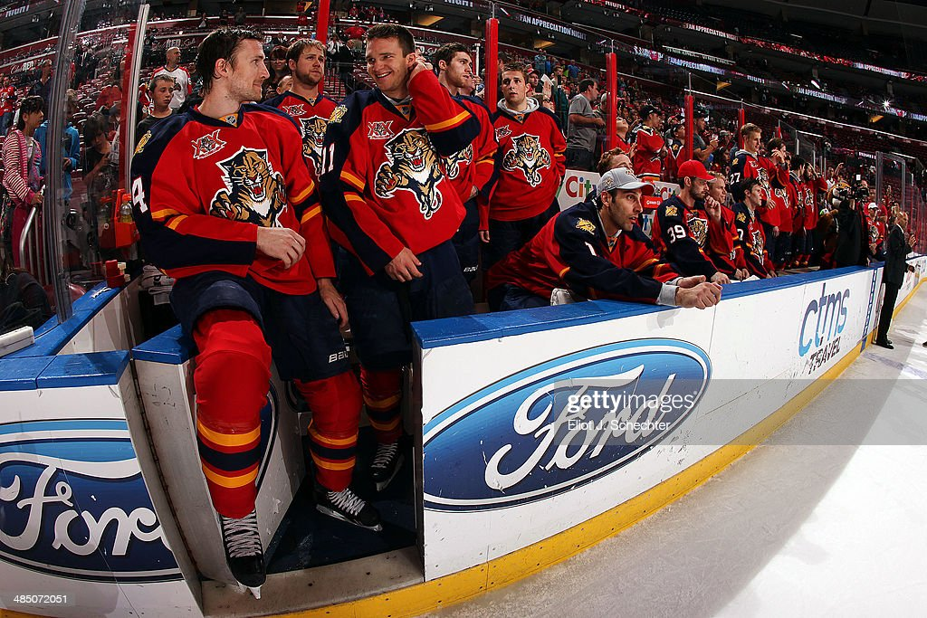 The Florida Panthers sit on the bench before giving their jerseys to fans after their final game of the season against the Columbus Blue Jackets at the BB&T Center on April 12, 2014 in Sunrise, Florida.