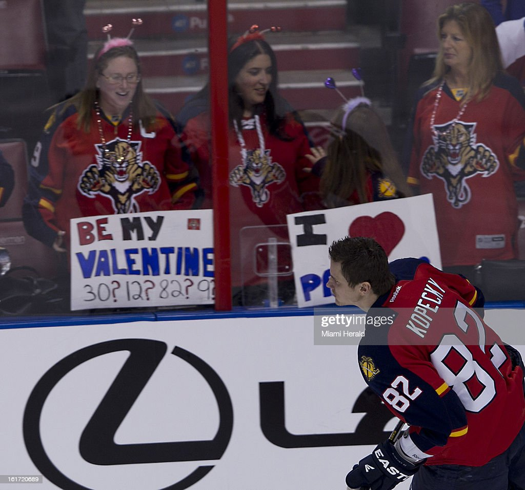 The Florida Panthers' Tomas Kopecky glides by a Panthers fan with a Valentines Day sign before action against the Montreal Canadiens at BB&T Center in Sunrise, Florida, on Thursday, February 14, 2013. Montreal won in OT, 1-0.
