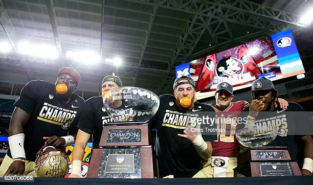 The Florida State Seminoles celebrate their 33 to 32 win over the Michigan Wolverines during the Capitol One Orange Bowl at Sun Life Stadium on...