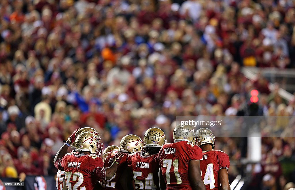 The Florida State Seminoles huddle during a game against the Florida Gators at Doak Campbell Stadium on November 24, 2012 in Tallahassee, Florida.