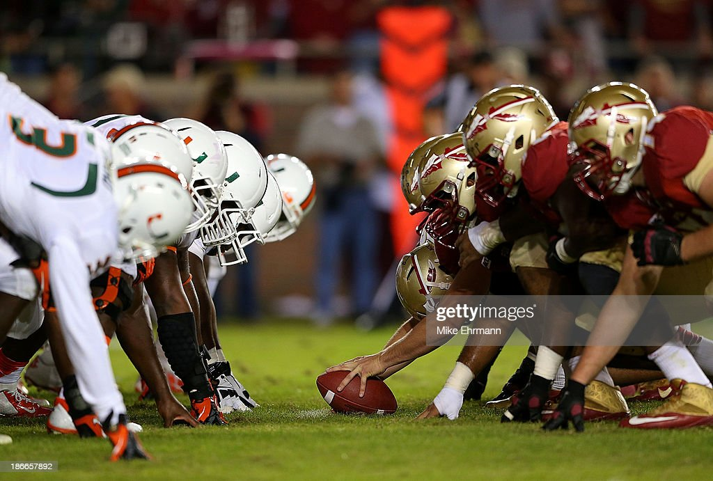 The Florida State Seminoles line up against the Miami Hurricanes during a game at Doak Campbell Stadium on November 2 2013 in Tallahassee Florida