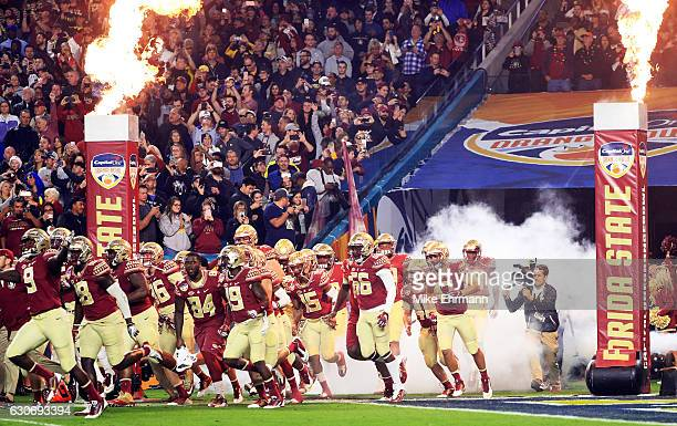The Florida State Seminoles take the field for the Capitol One Orange Bowl against the Michigan Wolverines at Sun Life Stadium on December 30 2016 in...