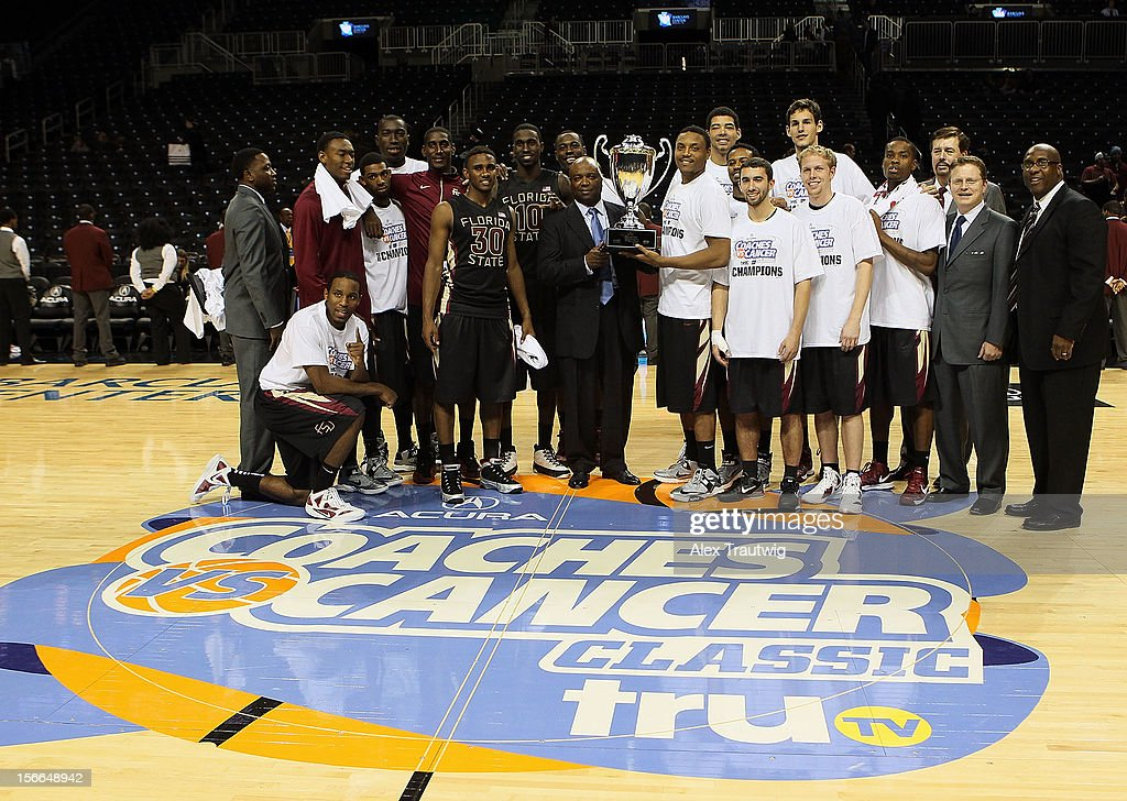 The Florida State University Seminoles pose on the court after winning the championship game of the Coaches Vs. Cancer Classic by a final score of 73-66 against the Saint Joseph's Hawks at the Barclays Center on November 17, 2012 in the Brooklyn borough of New York City.