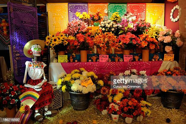 The flower vendor at the 'The Aroma of Life' display at the Mexican Cultural Center's Día de Muertos exhibit on Monday October 21 2013 The exhibit...