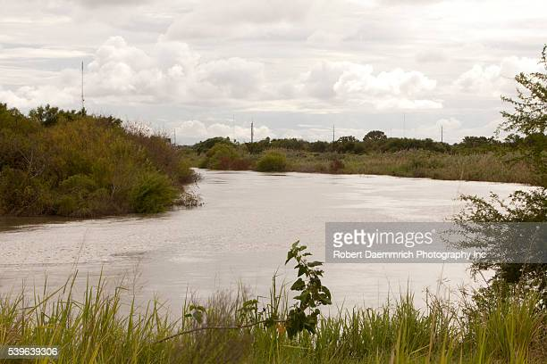 The flowing Rio Grande River between Matamoros Mexico and Brownsville Texas on Friday is relatively calm despite this week's drug violence in...