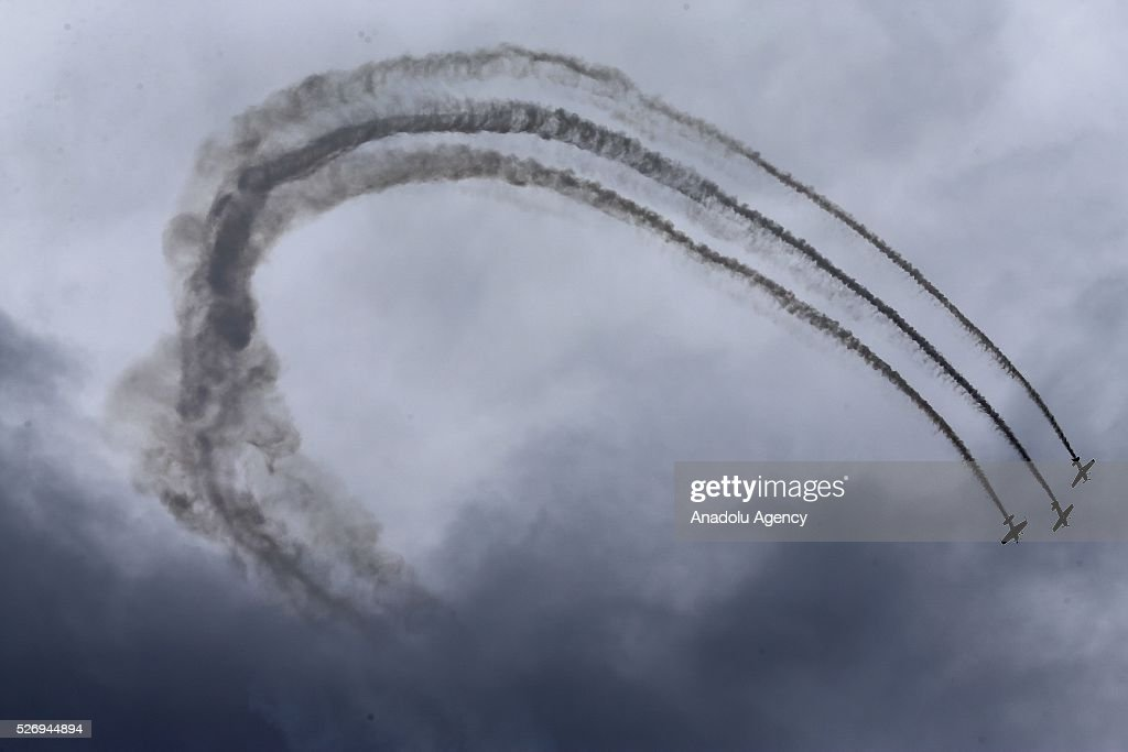 The Flying Bulls Aerobatics Team perform during an air show in Budapest, Hungary on May 1, 2016