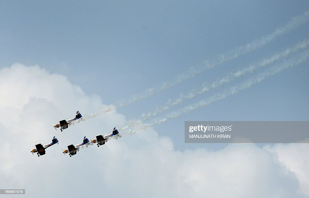 The 'Flying Bulls' considered one of the world's leading aerobatic display teams from the Czech Republic perform on the third day of Aero India 2013 at Yelahanka Air Force station in Bangalore on February 8, 2013. India, the world's leading importer of weaponry, opened one of Asia's biggest aviation trade shows February 6 with Western suppliers eyeing lucrative deals and a Chinese delegation attending for the first time. AFP/Manjunath KIRAN