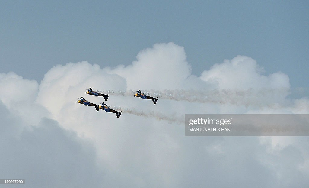 The 'Flying Bulls', considered one of the world's leading aerobatic display teams from the Czech Republic perform on the third day of Aero India 2013 at Yelahanka Air Force station in Bangalore on February 8, 2013. India, the world's leading importer of weaponry, opened one of Asia's biggest aviation trade shows February 6 with Western suppliers eyeing lucrative deals and a Chinese delegation attending for the first time. AFP/Manjunath KIRAN