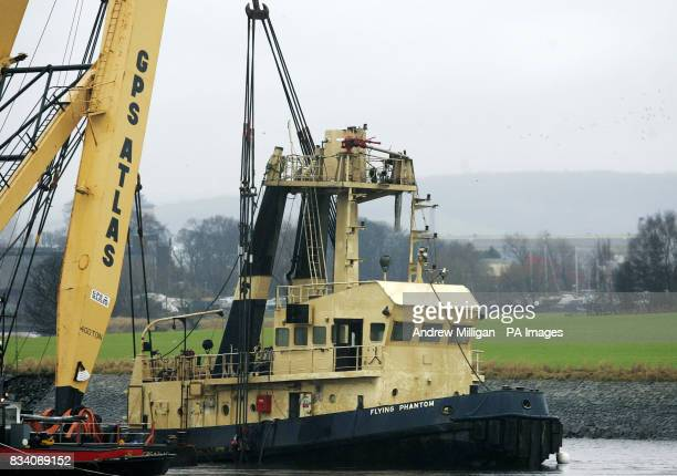 The Flying Phantom tug can be clearly seen as the barge GPS Atlas continues its salvage operation on the river ClydeThe Flying Phantom tug sank...