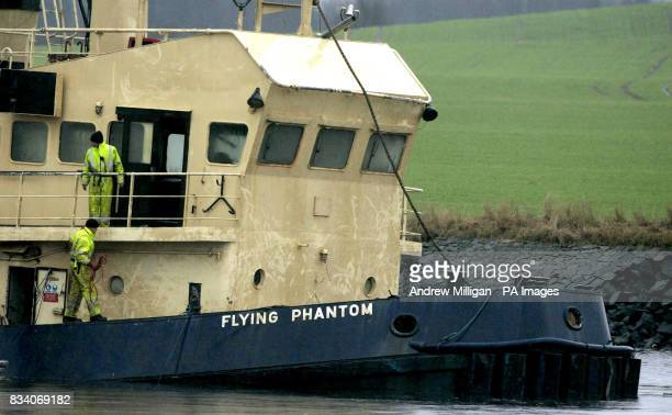 The Flying Phantom tug is visible as the barge GPS Atlas continues its salvage operation on the river ClydeThe Flying Phantom tug sank claiming the...
