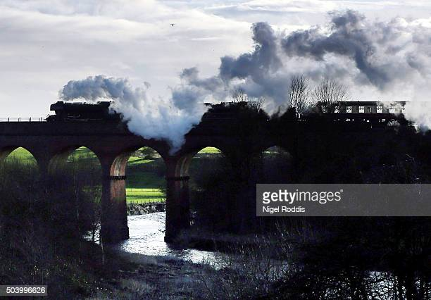 The Flying Scotsman crosses a viaduct during a test run along the East Lancashire line for the first time in ten years on January 8 2016 in Bury...