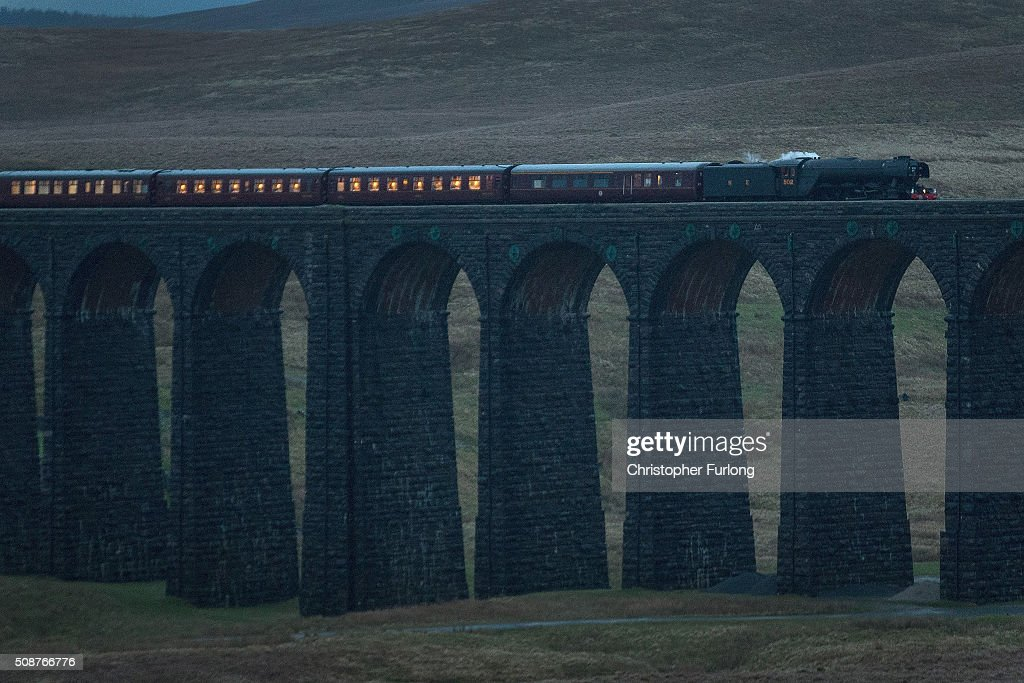 The Flying Scotsman hauls the Winter Cumbrian Mountain Express over the Ribblehead Viaduct on February 6, 2016 in Kendal, England. The Flying Scotsman is doing its first hauls since undergoing a £4.2m decade-long restoration. The legendary locomotive has been brought back to life so it can be exhibited at the National Railway Museum in York.