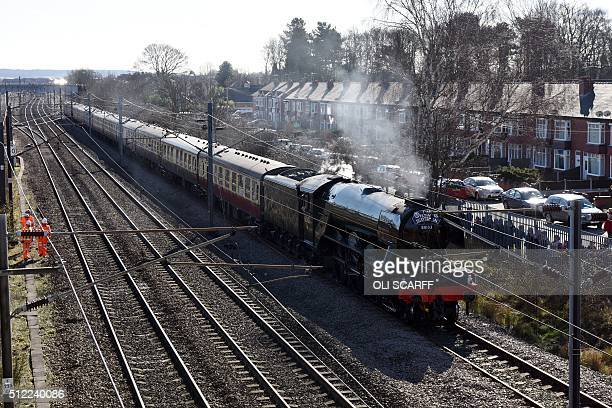 The Flying Scotsman steam locomotive travels along the East Coast Mainline near East Retford eastern England on February 25 2016 The Flying Scotsman...