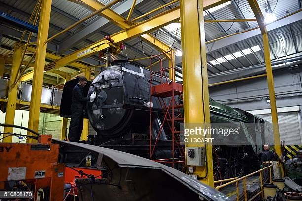 The Flying Scotsman steam locomotive undergoes restoration work in the National Railway Museum in York north west England on February 17 2016 The...