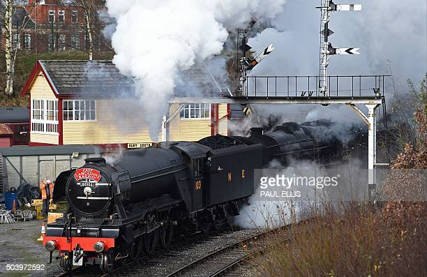 The Flying Scotsman steam train leaves Bury Bolton Street rail station in Bury north west England on January 8 on the East Lancashire Railway...