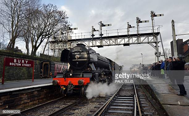 The Flying Scotsman steam train prepares to leave Bury Bolton Street rail station in Bury north west England on January 8 on the East Lancashire...