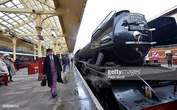 The Flying Scotsman steam train stands alongside a platform at Bury Bolton Street rail station in Bury north west England on January 8 on the East...