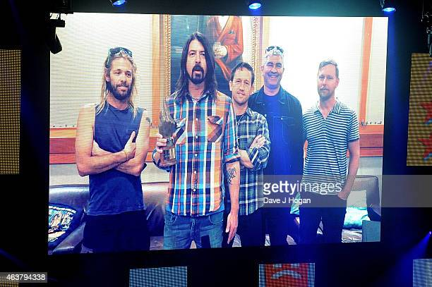 The Foo Fighters receive the Best International Band award via video link up at the NME Awards at Brixton Academy on February 18 2015 in London...
