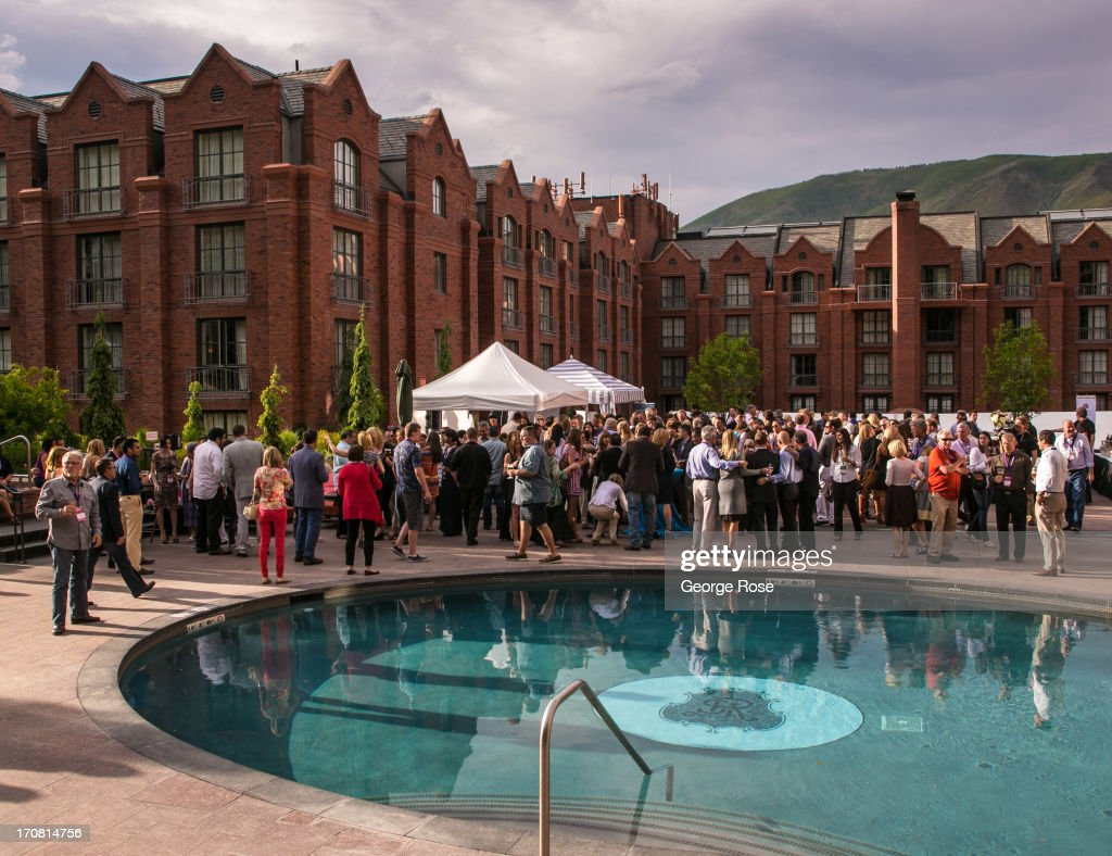 The Food & Wine Classic opening night party spills out into the pool area at the St. Regis Hotel on June 13, 2013, in Aspen, Colorado. The 31st Annual Food & Wine Classic brings together the world's top chefs and vintners in a culinary and beverage celebration.