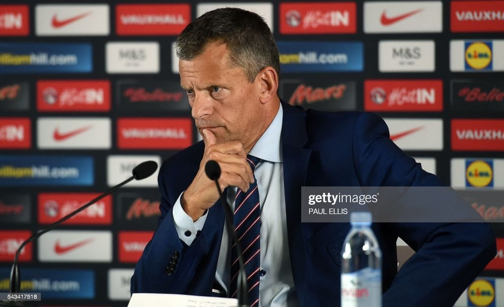 The Football Association's CEO Martin Glenn attends a press conference in Chantilly, northern France, on June 28, 2016, after Roy Hodgson's resignation as England's manager following the team's 2-1 defeat to Iceland during the Euro 2016 football tournament. / AFP / PAUL