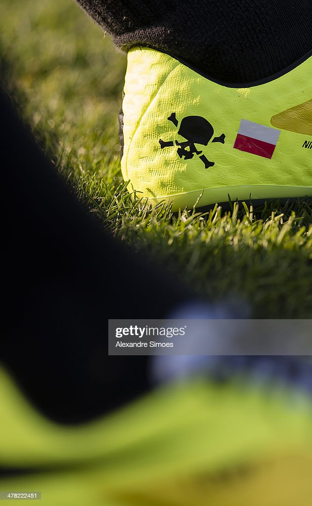 The football boots of Robert Lewandowski of Borussia Dortmund during a training session at Borussia Dortmund training ground on March 12, 2014 in Dortmund, Germany.